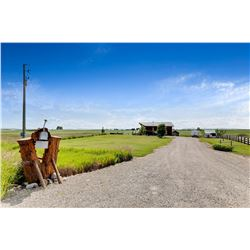 3.69 Acre Lot with 2300 sq ft Cabin Style Home, South of High River on Hwy 2A