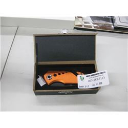 ORANGE FOLDING KNIFE IN BOX