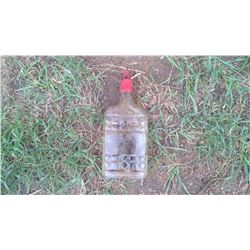 GLASS BOTTLE CONTAINING OIL