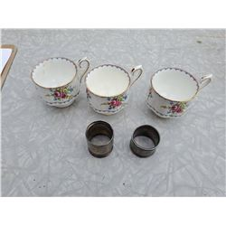 3 ROYAL ALBERT TEACUPS AND 2 SILVER NAPKIN RINGS