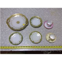 HAND-PAINTED, GOLD-COLOURED TRIM PLATES AND SAUCERS C/W MINIATURE TEACUPS