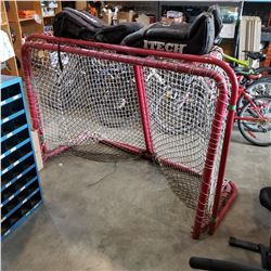 2 HOCKEY NETS AND GOALIE LEG PADS , MASK AND HOCKEY STICKS
