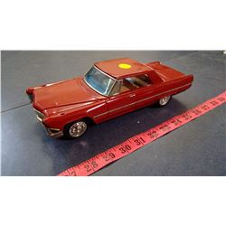 RED MODEL CADILLAC
