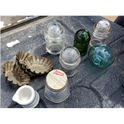 LOT OF INSULATORS & OLD CAFE CREAMER WITH OLD MUFFIN TINS.