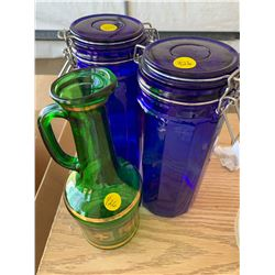 BLUE GLASS JARS AND GREEN GLASS PITCHER