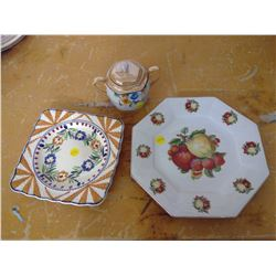 one floral plate, one fruit decorative plate, and a floral sugar dish