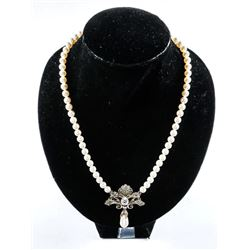 Ladies MMCrystal Pendant and Chain with White  Gold Plating. Bezel Pear Cut and Round Cut  Swarovski