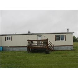 REAL ESTATE:  70 PLUS ACRES OF FENCED HAY AND PASTURE & 14' X 70' MOBILE HOME