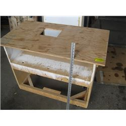 WOODEN TABLE ON CASTORS