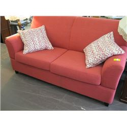 REDISH COLORED DAY BED SOFA WITH FOLD DOWN ARMS (AS NEW)
