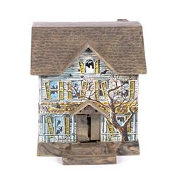 Haunted Mansion Tin Toy.