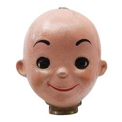 It's a Small World Animatronic Doll Head.