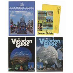 Set of (4) Walt Disney World Vacation & Resort Guides.