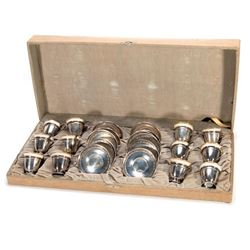 Cased sterling silver demi-tasse set