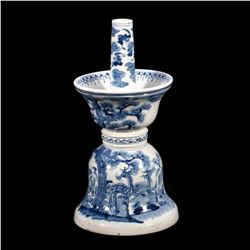A 18th-/19th century blue and white candlestick holder