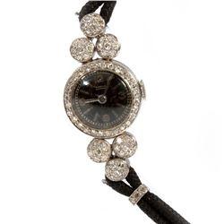 Gubelin diamond, platinum and cord ladies wristwatch