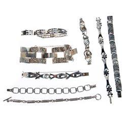 Eight sterling silver link bracelets