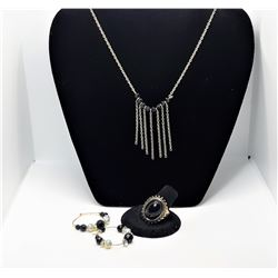 7)  SUITE OF GOLD TONE AND BLACK ONYX