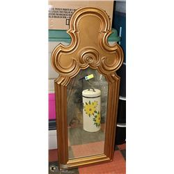 CARVED STYLE GOLD TONE FRAMED MIRROR.