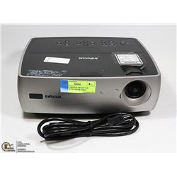 INFOCUS DIGITAL PROJECTOR. COMES WITH POWER CORD