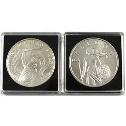 Pair of 1oz fine silver rounds. Lot includes: 2x Silver Shield rounds featuring A Hero is born & Fre