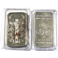 Pair of 1oz fine silver Decorative Art bars. Lot includes Jesus on Cross surrounded by Easter lilies