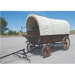 Covered Wagon, built on Pioneer Equipment running gear, leaf springs and hydraulic brakes, cushions