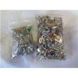 2 BAGS OF PINS, RINGS, ETC