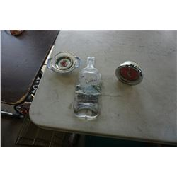PRESSED GREY GOOSE BOTTLE, MCM CLOCK, PLATES, LIGHTER, ETC