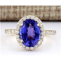 4.30 CTW Natural Tanzanite And Diamond Ring In 18K Yellow Gold