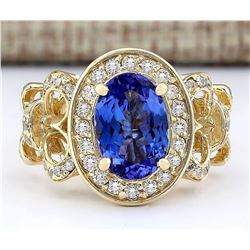 3.93 CTW Natural Tanzanite And Diamond Ring In 18K Yellow Gold