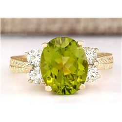 4.31 CTW Natural Peridot And Diamond Ring In 14k Yellow Gold