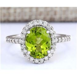 3.03 CTW Natural Peridot And Diamond Ring In 18K White Gold