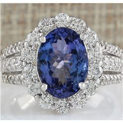 5.46 CTW Natural Blue Tanzanite And Diamond Ring In 18K White Gold