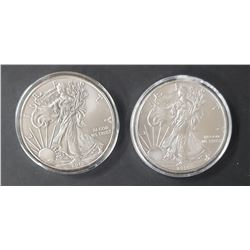 2 - 2014 and  2010  American Silver Eagles 1 oz 99