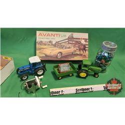 Tray Lot: Avanti (Model - Missing Parts) (1:25 Scale) & 2 Toy Tractors, Jar of Marbles, Fishing Reel