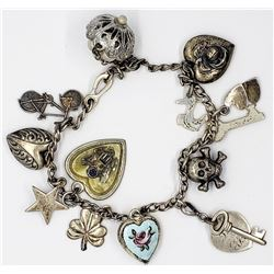 VINTAGE LOADED STERLING CHARM BRACELET