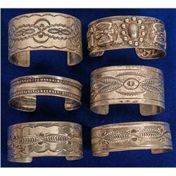 Six Navajo Stamped Cuffs  (121116)