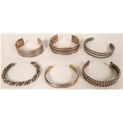 Six Twisted Silver Bracelets  (121115)