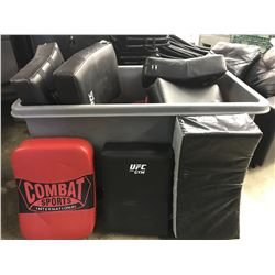 BIN OF ASSORTED UFC AND OTHER BLOCKING BAGS