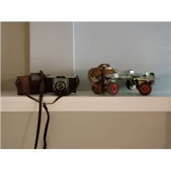 VINTAGE RARE PAIR OF ROLLER SKATES AND CAMERA BOTH SELLING AS ONE LOT NO RESERVE