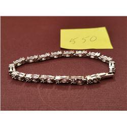 Amethyst and rhinestone sivertone bracelet by Avon