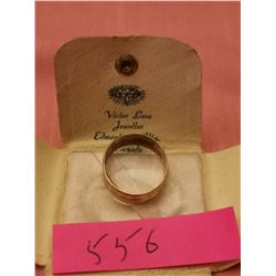 10 kt Gold band size 8
