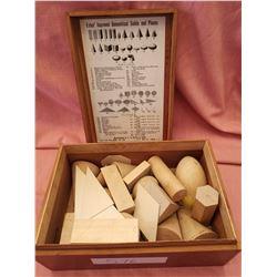 Geometrical set by Elihu Beach Estes in wooden box, 1917