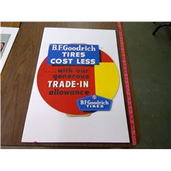 "B.F. GOODRICH CARBOARD SIGN ""TIRES COST LESS"" NOS"
