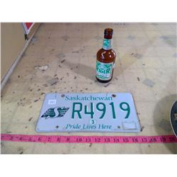 ROUGH RIDER LICENSE PLATE AND RIDER PRIDE BEER BOTTLE