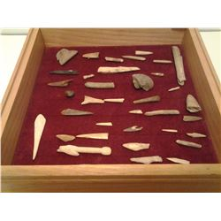 Bone points (37 pieces) in a wooden display case