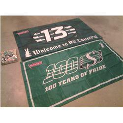 Saskatchewan Roughriders book & 2 flags