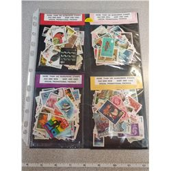 Four 100 stamp packages, nice assortment