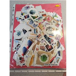 double sided pakage of stamps, Canadian, U.S. & worldwide
